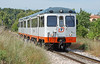 FGV 2 Car DMU 2312 arrives at Denia 31 May 2010. This unit built in 1984 is still in traffic, with two spare cars stored at La Marina workshops Alicante.  Note the wing mirrors on the cab ends for door closure & the destination boards over the doors.
